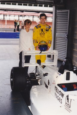 Ann and me with my Yellow Pages livered F3 car at Donington Park in 1997.